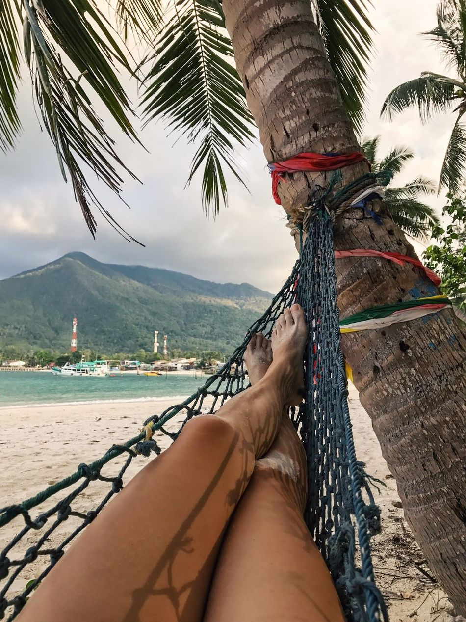 Palm Tree Sea Nature Sky Water One Person Outdoors Beach Day Personal Perspective Palm Tree Hammock Lying Down Relaxation Human Body Part Human Leg Human Foot Women Travel Destinations Idyllic Scenery Tranquility Tourist Thailand Bounty Island Island Life