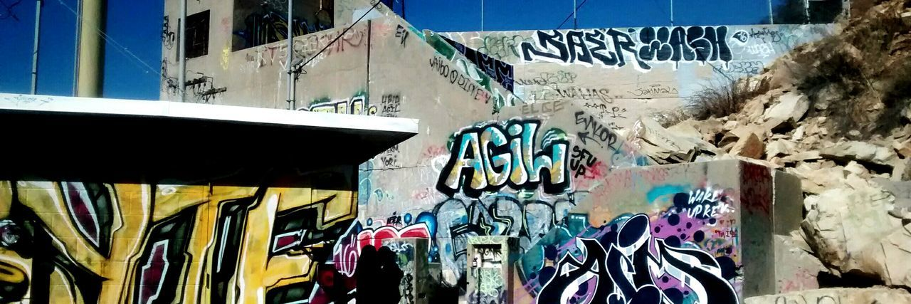 graffiti, architecture, built structure, building exterior, multi colored, text, day, outdoors, no people