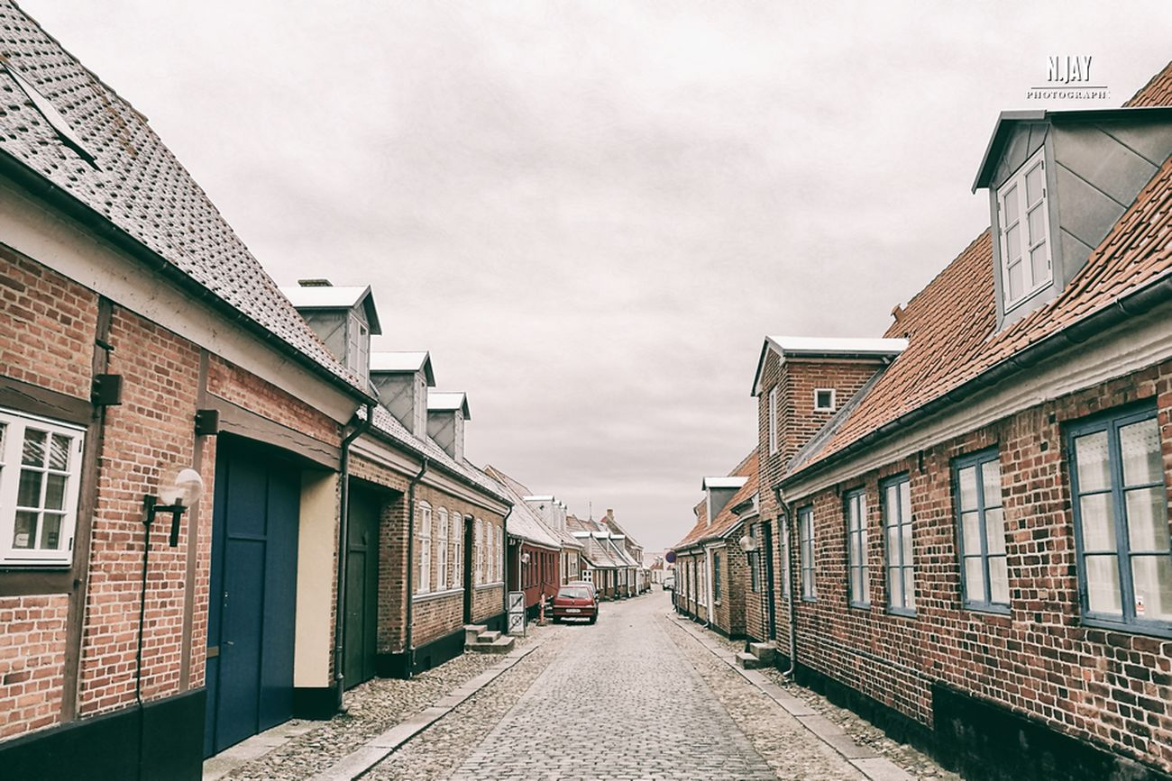 Streets of Ringkøbing Streetphotography Street Streetphoto_color Architecture Architecture_collection Houses City Ringkøbing Denmark Denmark 🇩🇰 WinterArchitecture Cityscape Eye4photography  EyeEm Masterclass Adapted To The City Lifestyles Hygge Architectural Feature Windows Doors Alley Alleyway History City