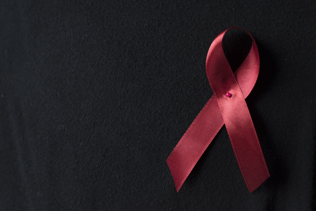 red ribbon (aids ribbon) on black cloth background.Aids / HIV Concept. healthcare and medical concept Care Death Fight Healthcare Hope Icon Red Ribbon SUPPORT Aids Awareness Background Blood Campaign Cure Day Fighter Hiv Immune Prevention Stop Symbol Treatment Virus World