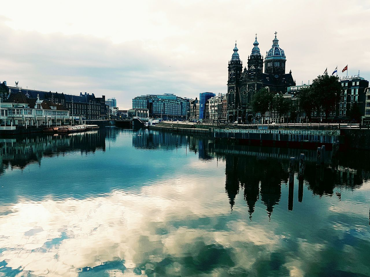 architecture, built structure, building exterior, sky, water, cloud - sky, reflection, outdoors, waterfront, travel destinations, place of worship, no people, day, nature, city