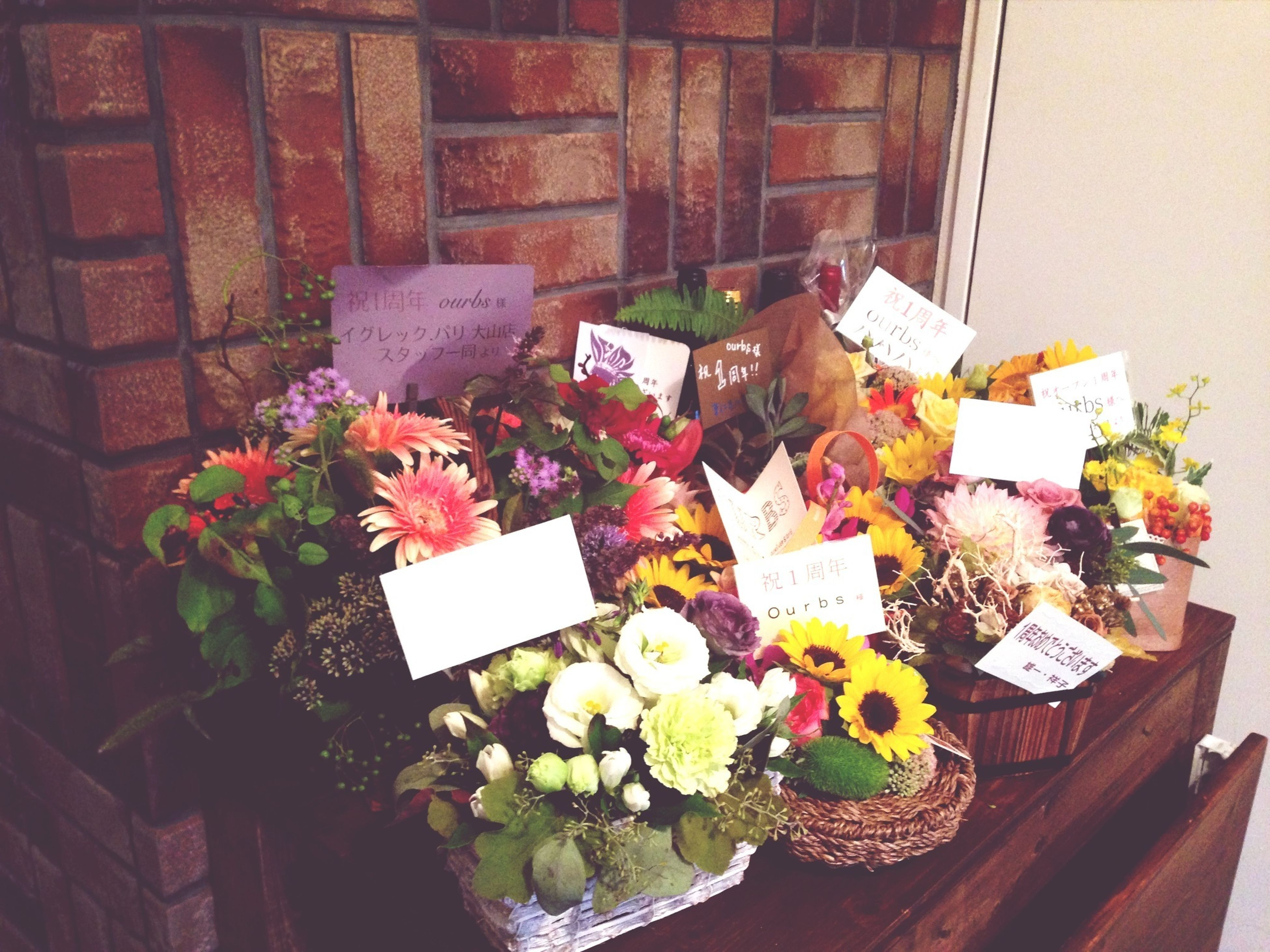 flower, freshness, indoors, variation, table, bouquet, high angle view, arrangement, large group of objects, abundance, still life, choice, potted plant, multi colored, fragility, decoration, plant, no people, bunch of flowers, vase