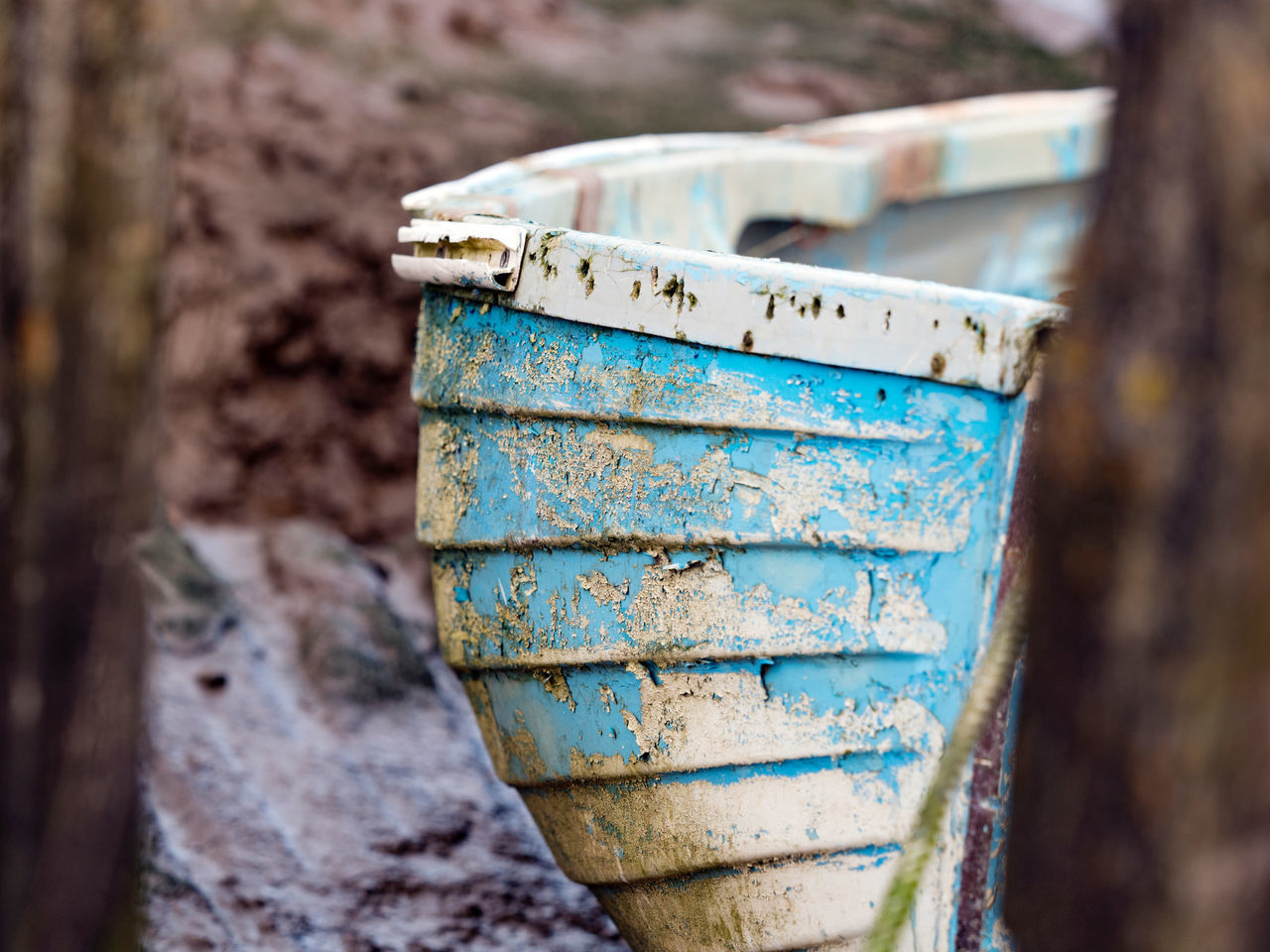 Flaked Paint ( boat ) 02. Morston Quay is a small village in North Norfolk. The quay has plenty of history and more than it's fair share of mud ! Spring and summer is busy with boat trips to see the seals. Olympus Pen F with 40-150 f2.8. Edit in Capture One pro. Beauty In Ordinary Things Beauty Of Decay Blue Boat Boat Trip Close-up Day Depth Of Field EyeEm Best Shots EyeEm Gallery Fine Art Photography Flaking Paint Mud Nature No People Norfolk Outdoors Pattern, Texture, Shape And Form Textures And Surfaces Walking Around Weathered Worn Out