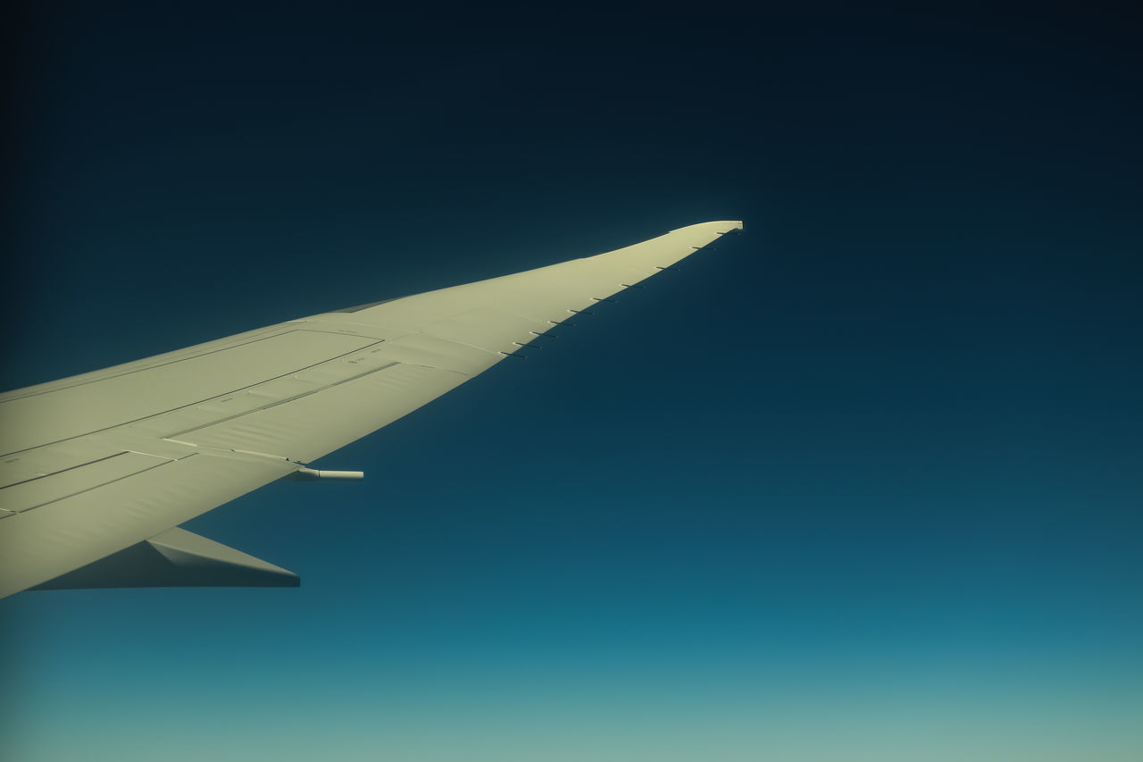 Reaching altitude Air Vehicle Aircraft Wing Airplane Airplane Wing Clear Sky Day Flying Journey Mid-air Mode Of Transport No People Outdoors Plane Sky Transportation Travel