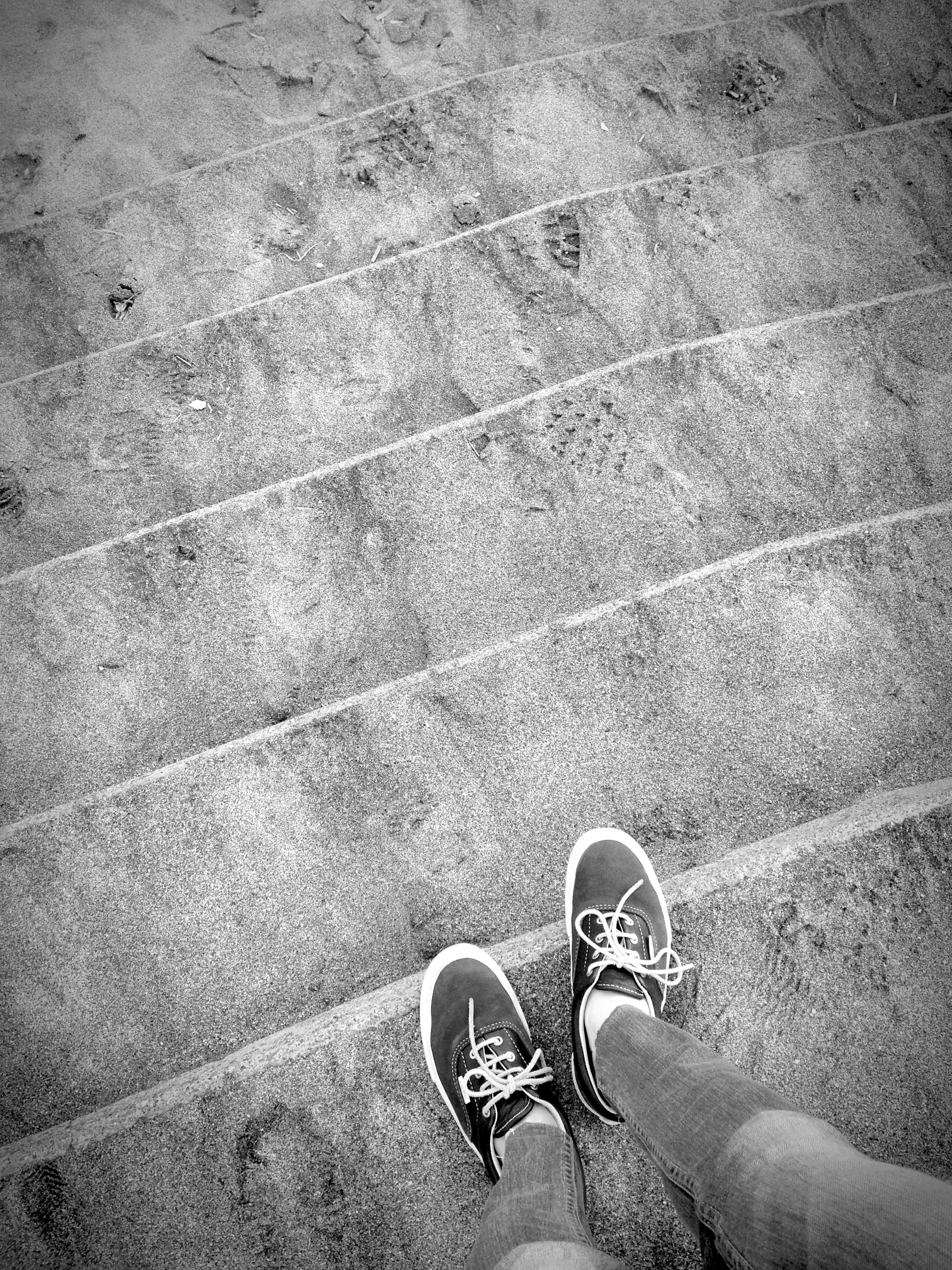 low section, person, shoe, personal perspective, human foot, footwear, lifestyles, high angle view, standing, leisure activity, men, unrecognizable person, directly above, part of, street, canvas shoe