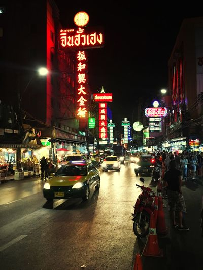 Illuminated Night Building Exterior Street Architecture Transportation Mode Of Transport City Built Structure Land Vehicle Text Road Outdoors Large Group Of People Car Real People Nightlife Neon Sky