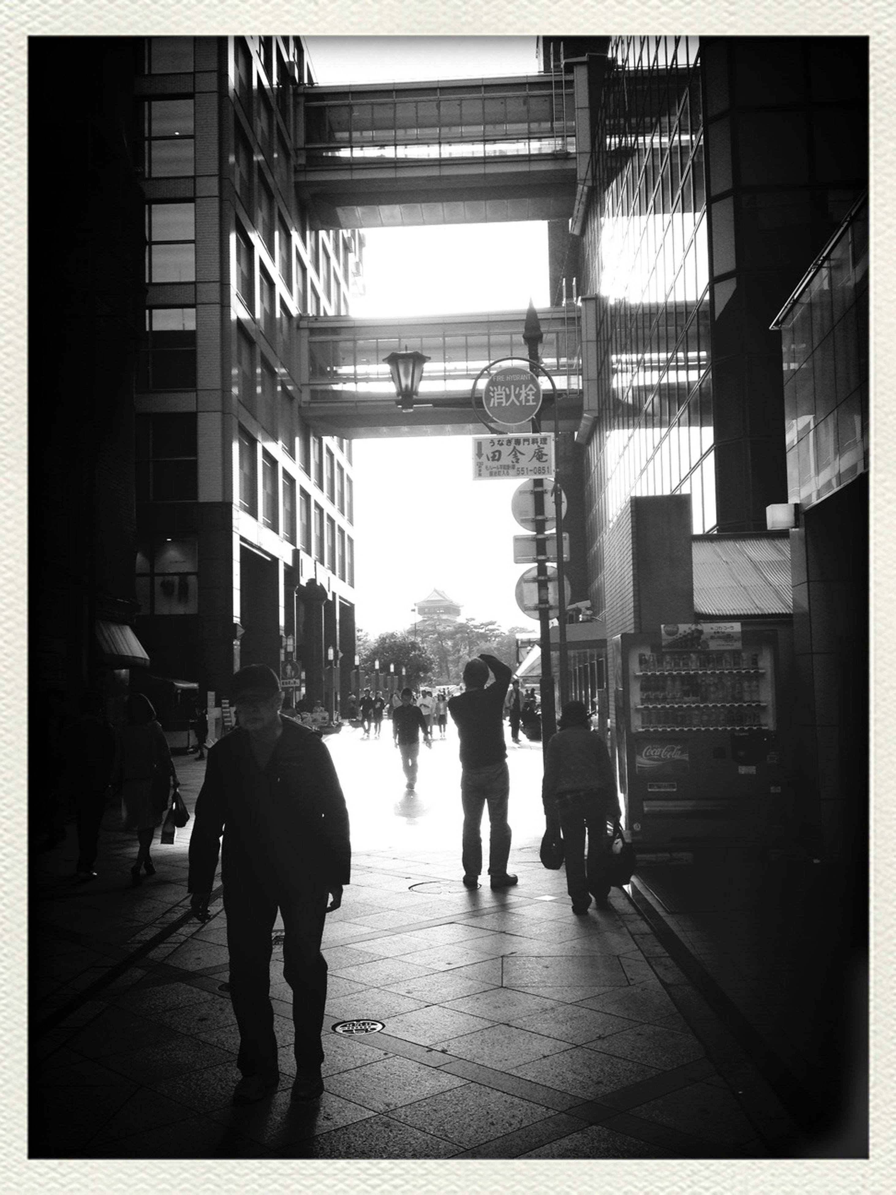transfer print, architecture, walking, built structure, men, auto post production filter, building exterior, person, full length, lifestyles, city, city life, street, rear view, large group of people, building, day, group of people, sidewalk
