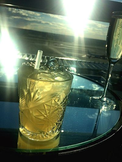 Enjoying a Lynchburg Lemonade and some Cava in the sunset over Uppland Lynchburg Lemonade Cava Arlanda Airport Sunset Drinks
