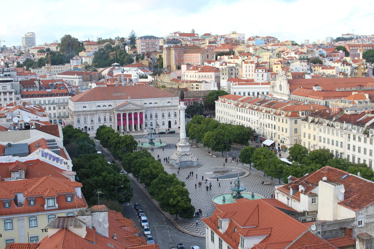 Rossio. Architecture Arts Culture And Entertainment City City Landscape Fountain Lined Lisbon Main Square Plaza Portugal Rooftops Trees Views