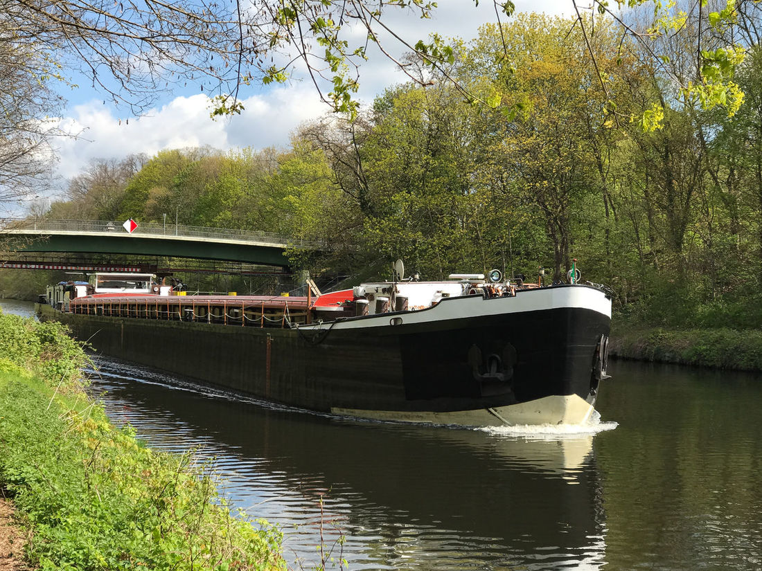 inland water vessel Artificial Watercourse Barge Beauty In Nature Boat Canal Day Inland Navigation Vessel Inland Water Vessel Inland Waterway Craft Mode Of Transport Nature Nautical Vessel No People Outdoors River Barge River Boat Sky Transportation Water Watercourse Waterfront Waterway