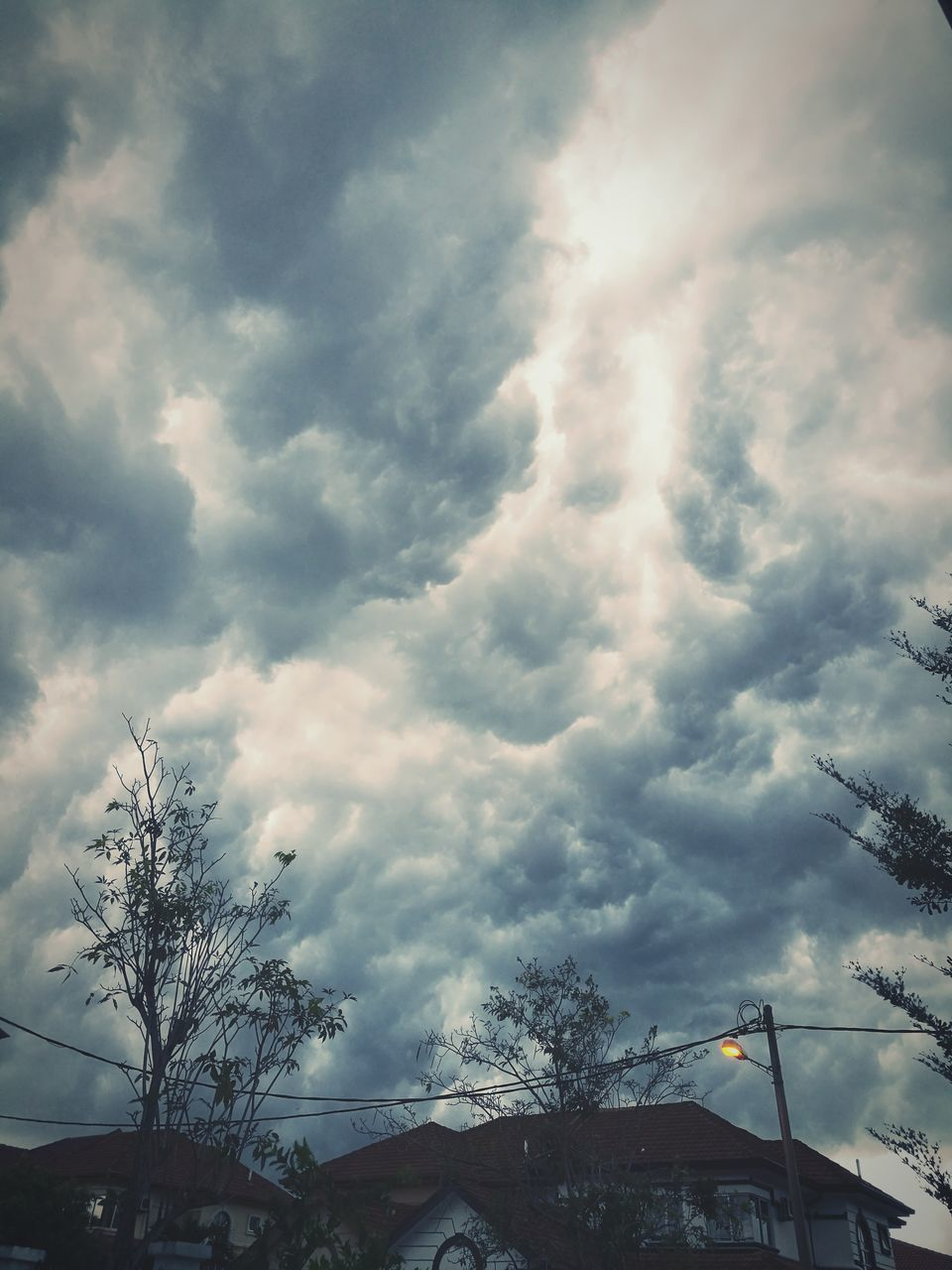 cloud - sky, sky, weather, low angle view, no people, beauty in nature, nature, outdoors, tree, day, storm cloud, building exterior, architecture