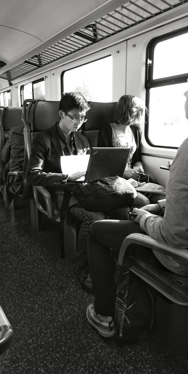 Commuting Commuters are these Two People a Couple? She Looks Outside her Thoughts FAR AWAY . He looks Mesmerized at his Laptop , his thoughts far away as well? Or are they Closer Then They Seem ? Train Way Back Home (c) 2016 Shangita Bose All Rights Reserved The Essence Of Summer Monochrome Black And White My Commute Feel The Journey The Mix Up On The Way Internet Addiction