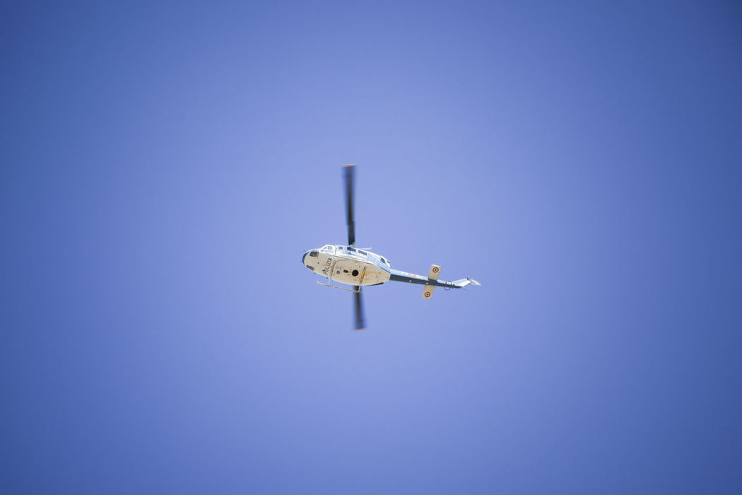 Police helicopter in action Blue Clear Sky Fly Fly High Flying Helycopter Nature No People Outdoors Security Check