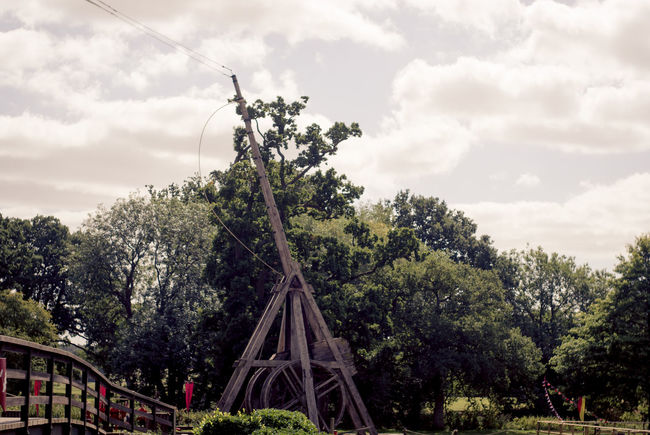 Architecture Building Exterior Built Structure Cloud Cloud - Sky Cloudy Connection Day Green Color Growth Low Angle View Nature No People Outdoors Plant Railing Sky The Way Forward Transportation Trebuchet Tree