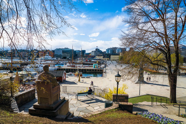 Oslo City Hall promenade Architecture Bare Tree Blue Building Exterior Built Structure City Cityscape Cloud Cloud - Sky Day Harbor House Lake Nature Oslo Promenade Residential Building Residential Structure River Rolf Stranger Plass Sky Spring Sunlight Tree Water