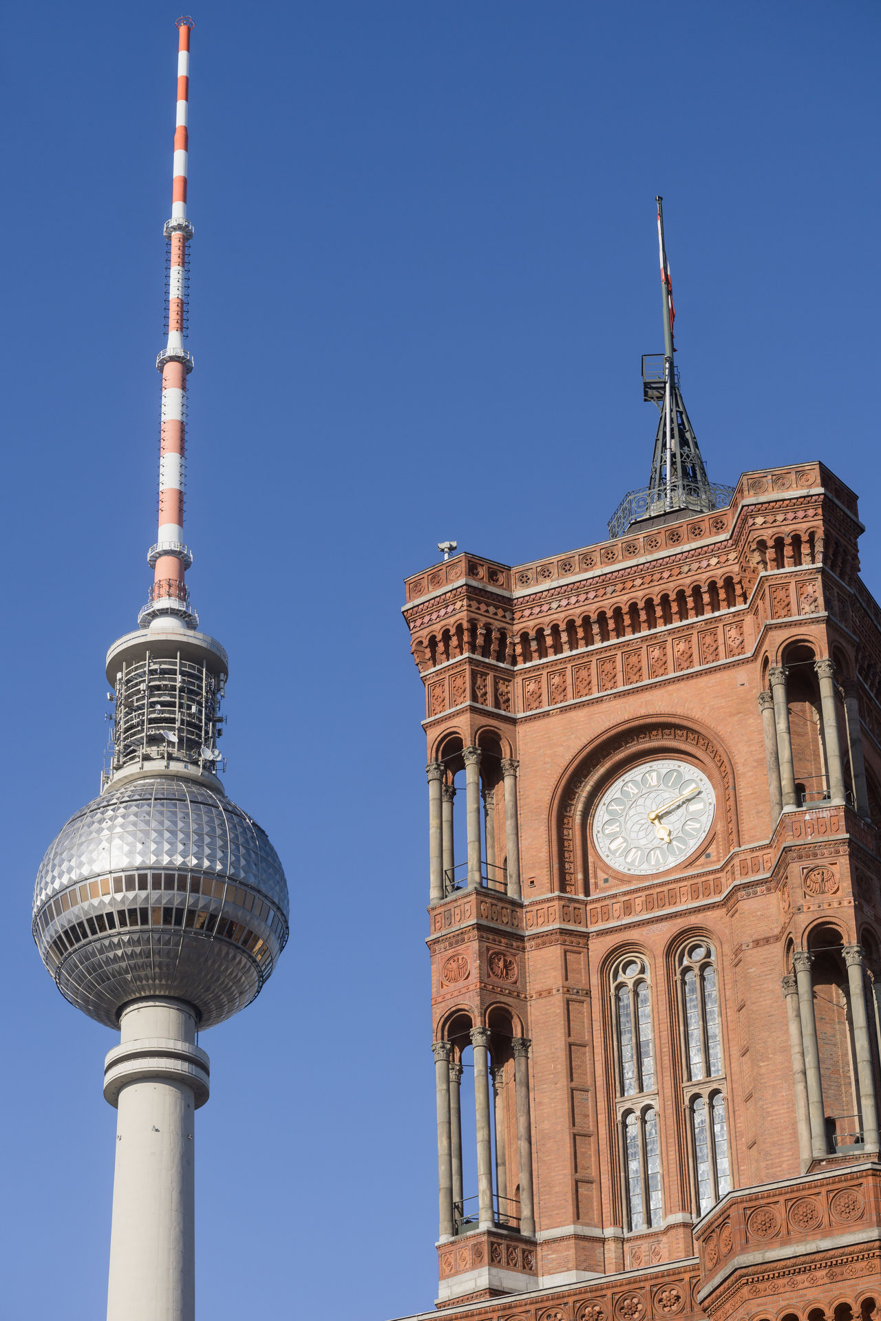 TV Tower and City Hall in Berlin, Germany Alexanderplatz Architecture Berlin Broadcasting City City Hall Communication Day Fernsehturm Germany No People Outdoors Rotes Rathaus Sky Tourism Tower Travel Travel Destinations TV Tower Urban Skyline