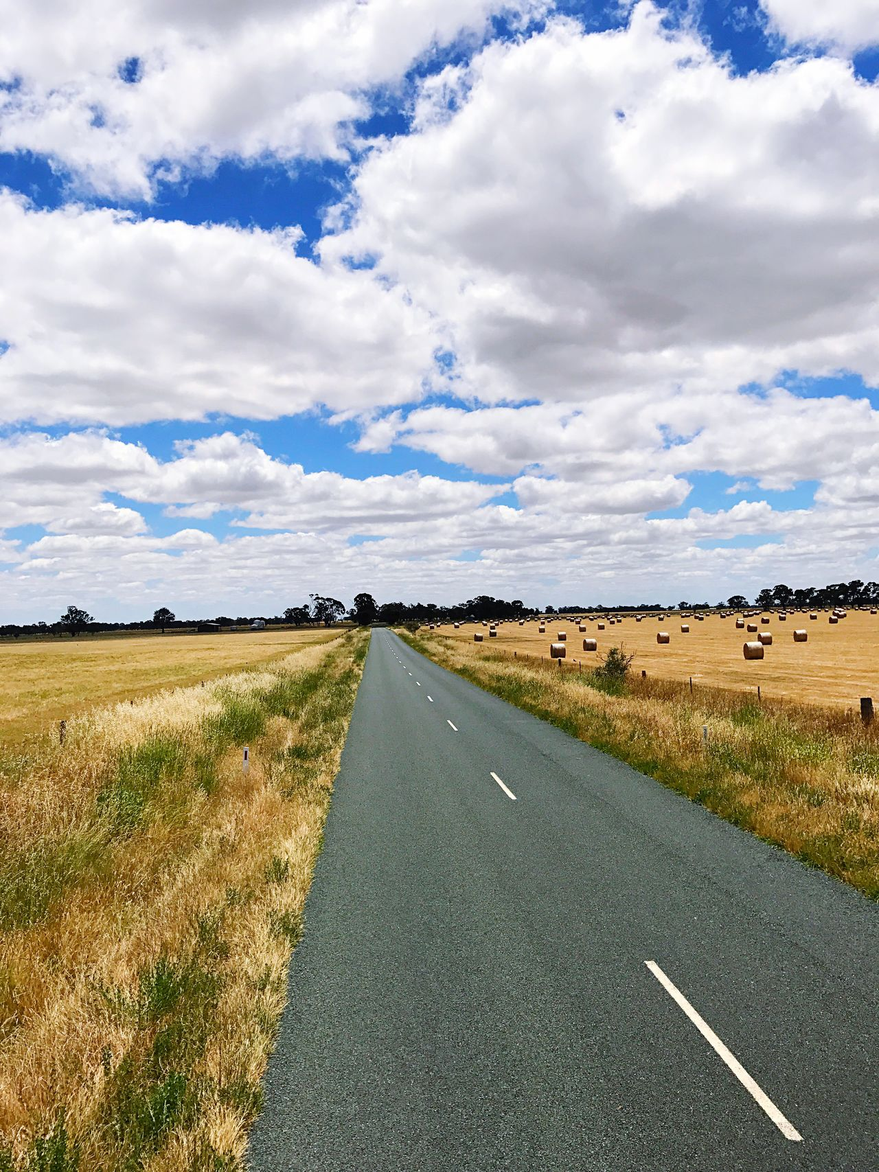 Cloud - Sky Sky Road Landscape The Way Forward Nature Scenics Transportation Haystack Street No People Outdoors Day Grass Beauty In Nature