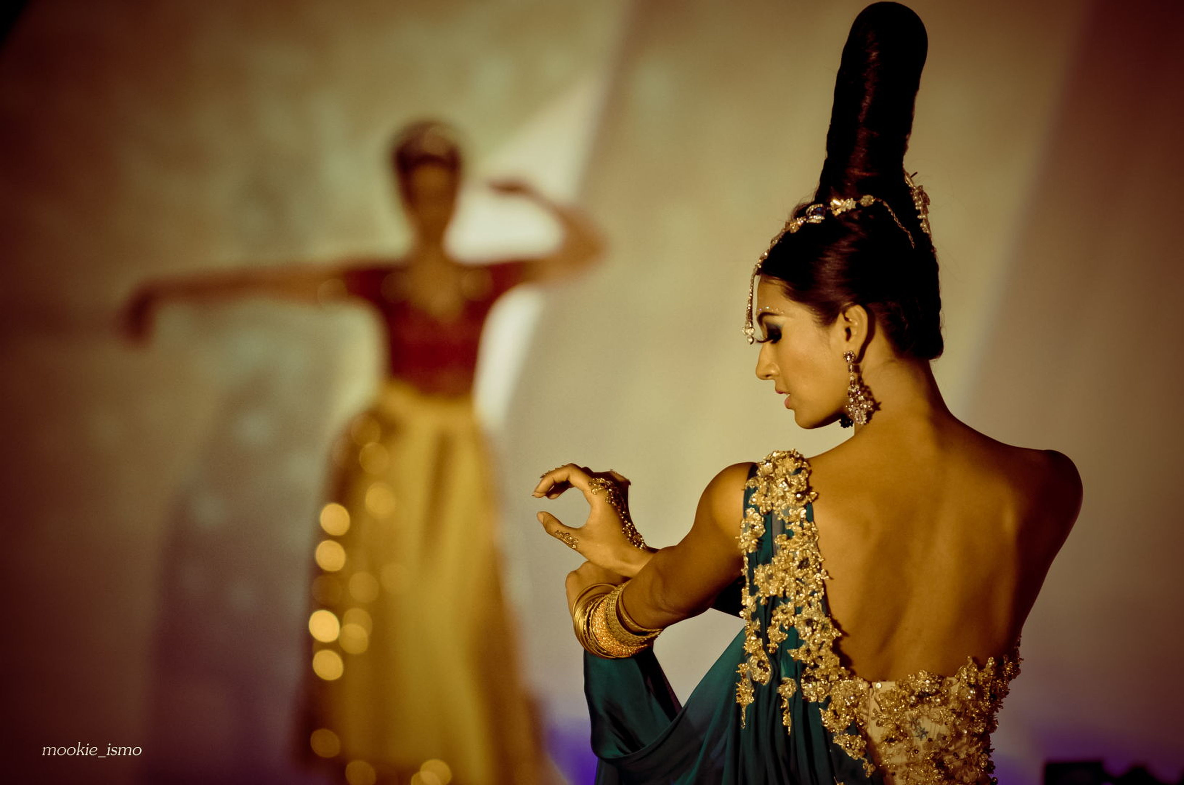 lifestyles, leisure activity, young adult, holding, casual clothing, standing, three quarter length, focus on foreground, person, arts culture and entertainment, waist up, indoors, front view, young women, music, illuminated, night, celebration