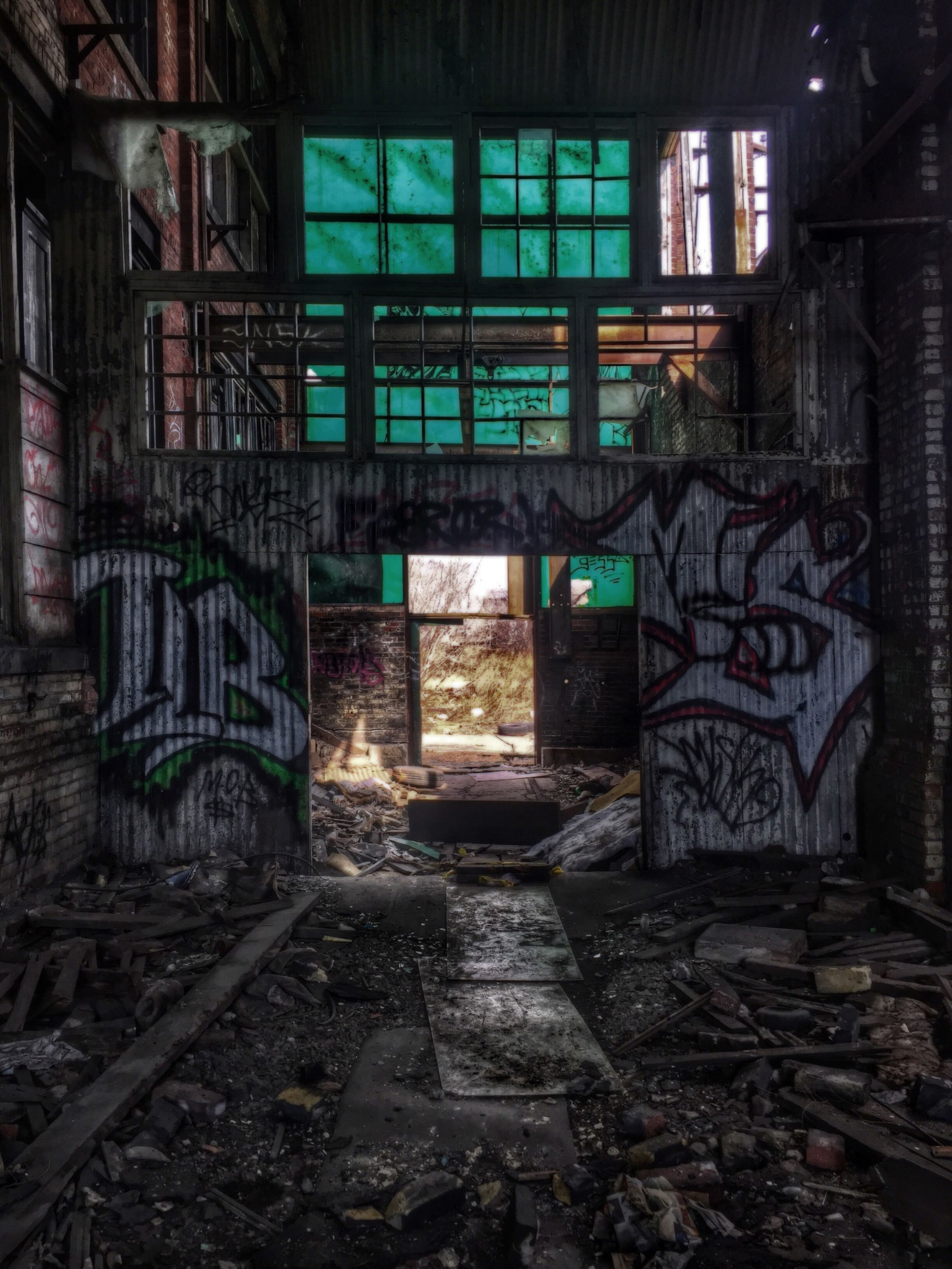 graffiti, architecture, built structure, abandoned, obsolete, damaged, run-down, indoors, deterioration, messy, building exterior, old, wall - building feature, art, house, art and craft, building, creativity, door, day