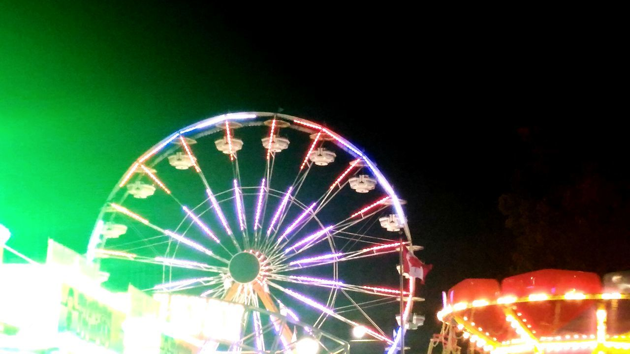Eastern States Expo aka The Big E. Ferris wheel Green Light Ferris Wheel Ferris Wheel At Night Ferriswheel Amusement Park Ride Amusement Park Arts Culture And Entertainment Low Angle View Large Big Wheel Multi Colored No People Sky Lights Kiddie Ride Colorful Lights Colorful Life Big Wheel 🎡 Ferris Wheel Colour Of Life Colors Of Carnival Color Big Wheel Large Asuszenfone2laser Asus Zenfone Photography