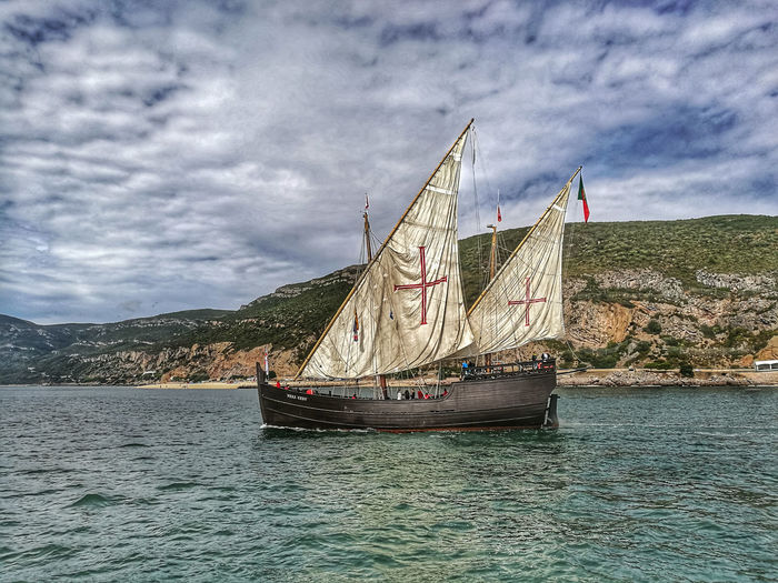 "HDR Caravela Portuguesa ""Vera Cruz"" Nautical Vessel Transportation Waterfront Water Sky Mode Of Transport Cloud - Sky Sailboat Sailing Cloudy Mountain Sea Nature Outdoors Scenics Cloud Day Tranquil Scene Beauty In Nature Sailing Ship Capturedonp9 HuaweiP9 Caravella Caravel Ship Setúbal Portugal"