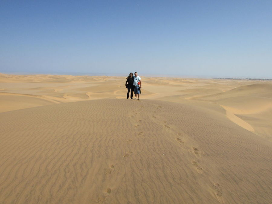 Full Length Sand Clear Sky Landscape Desert Rear View Transportation Shadow Sunlight Sand Dune Men Remote Tranquil Scene Solitude Tranquility Horizon Over Land Riding Blue Arid Climate Day Desert Adventure My Year My View
