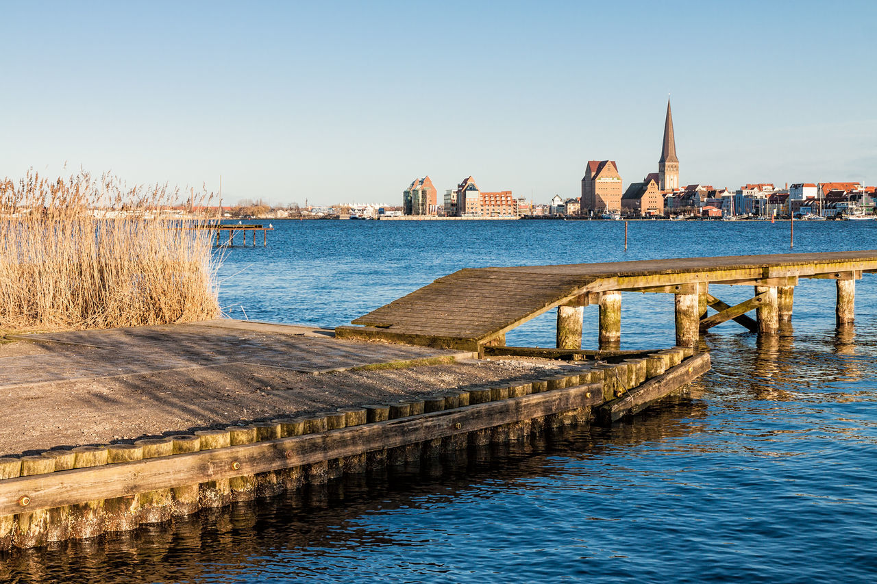 View over the river Warnow to Rostock, Germany. Architecture Building Exterior Church City Clouds And Sky Day Holiday No People Outdoor Outdoors Reeds River Sky Sky And Clouds Tourism Town Travel Travel Destinations Vacation Warnow Water