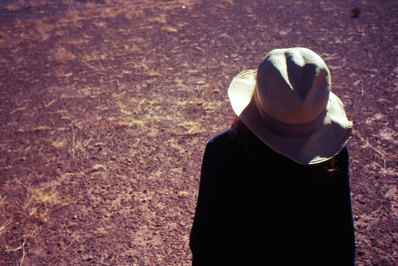hat, one person, real people, rear view, outdoors, sunlight, day, standing, shadow, lifestyles, men, people