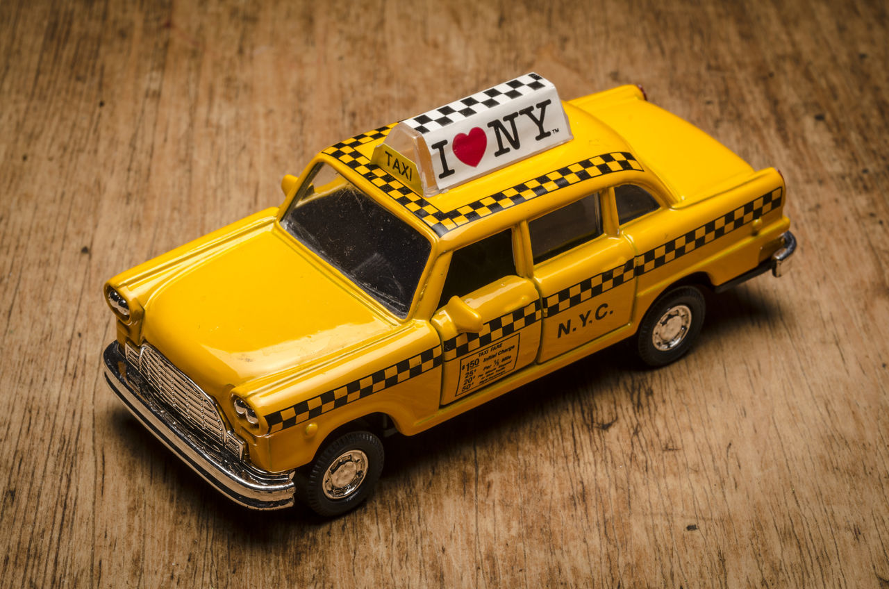 New York City Yellow Taxi Model Car, The old fashioned Checker Cab, Checker Cabs were the most popular in New York American Checkered NYC New York Taxi Transport Transportation USA Cab Checker Fashioned Model Nobody Old Public Small Style Taxicab Toy Toy Car Traditional Vehicle Yellow