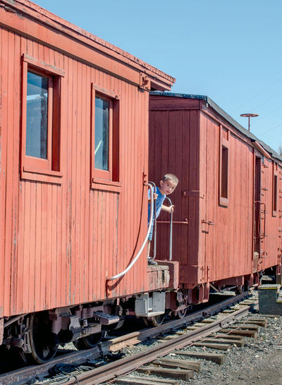 a cute little boy peeks out of a box car he was exploring at a train museum in Colorado caboose box cars large metal technology safety outdoors train station train museum Colorado USAtrip america colorado train Museum editorial education Railway Lines history editorial photography train - vehicle Train Tracks child childhood Fun explore hispanic Imigration Dreamers Caboose Box Cars Large Metal Technology Safety Outdoors Train Station Train Museum Colorado USAtrip America Colorado Train Museum Editorial  Education Railway Lines History Editorial Photography Train - Vehicle Train Tracks Child Childhood Fun Explore Transportation Rail Transportation Railroad Track