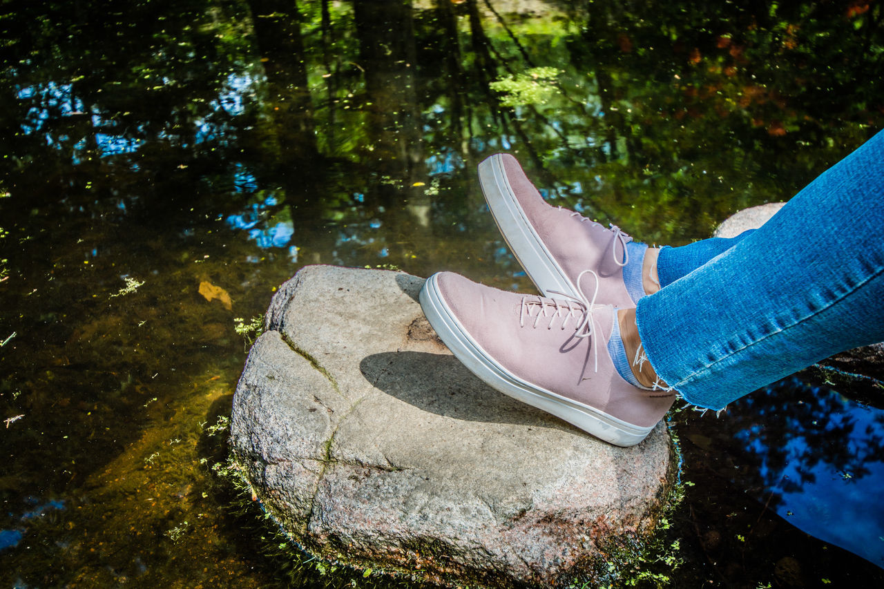 low section, shoe, one person, human leg, real people, human foot, human body part, water, outdoors, day, standing, lifestyles, close-up, adult, people