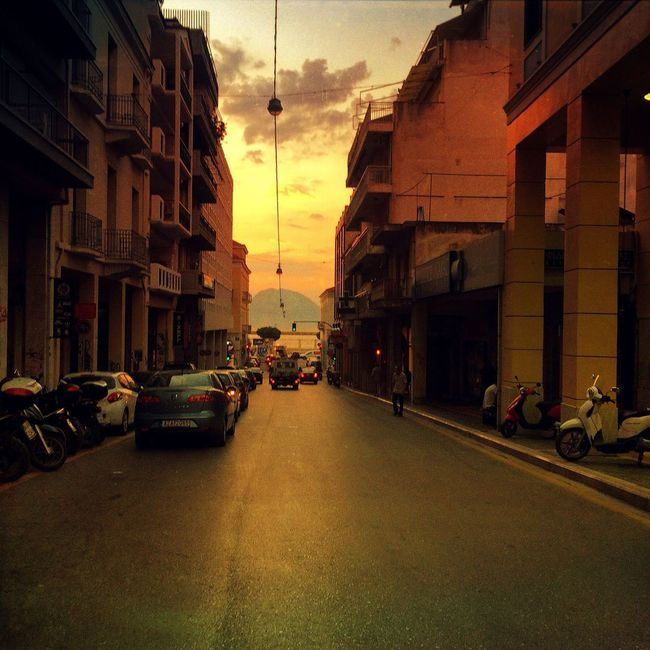 Inner city colors Built Structure Architecture Building Exterior Transportation Car Land Vehicle Sunset Mode Of Transport Street Road City Dusk Building Parking Sky Cloud - Sky City Street Group Of People The Way Forward Orange Color
