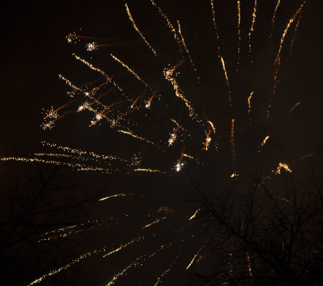 night, firework display, celebration, firework - man made object, long exposure, exploding, glowing, illuminated, event, outdoors, low angle view, no people, motion, arts culture and entertainment, sky, firework