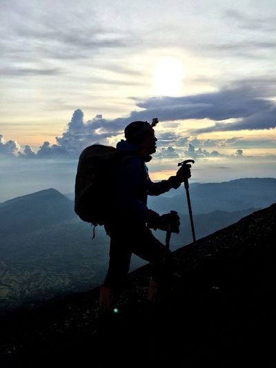 Tripod One Man Only One Person Camera - Photographic Equipment Photography Themes Silhouette Only Men Photographing Full Length Adult People Adults Only Side View Men Photographer Standing Water Holding Cloud - Sky Adventure INDONESIA Rinjanipeak Rinjani National Park Rinjanimountain Crater Lake