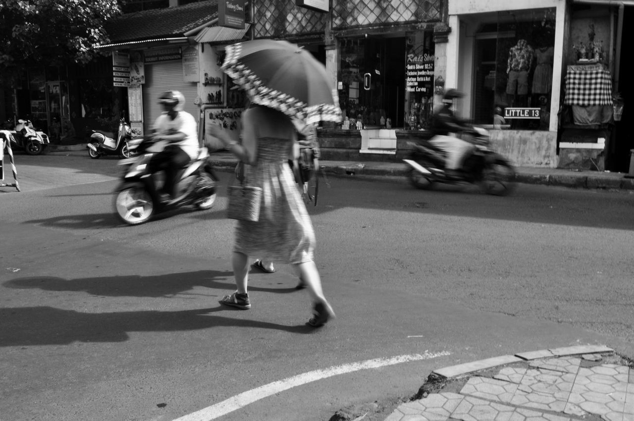 orchestra B&w Street Photography Bali Bali Indonesia Casual Clothing City Life City Street Crossing The Street Everybodystreet Lifestyles Mode Of Transport Monochrome Motorbikes On The Move Outdoors Road Scooters Shadow Street Streetphotography Traffic Intersection Transportation Travel Umbrella Urban Woman With A Parasol
