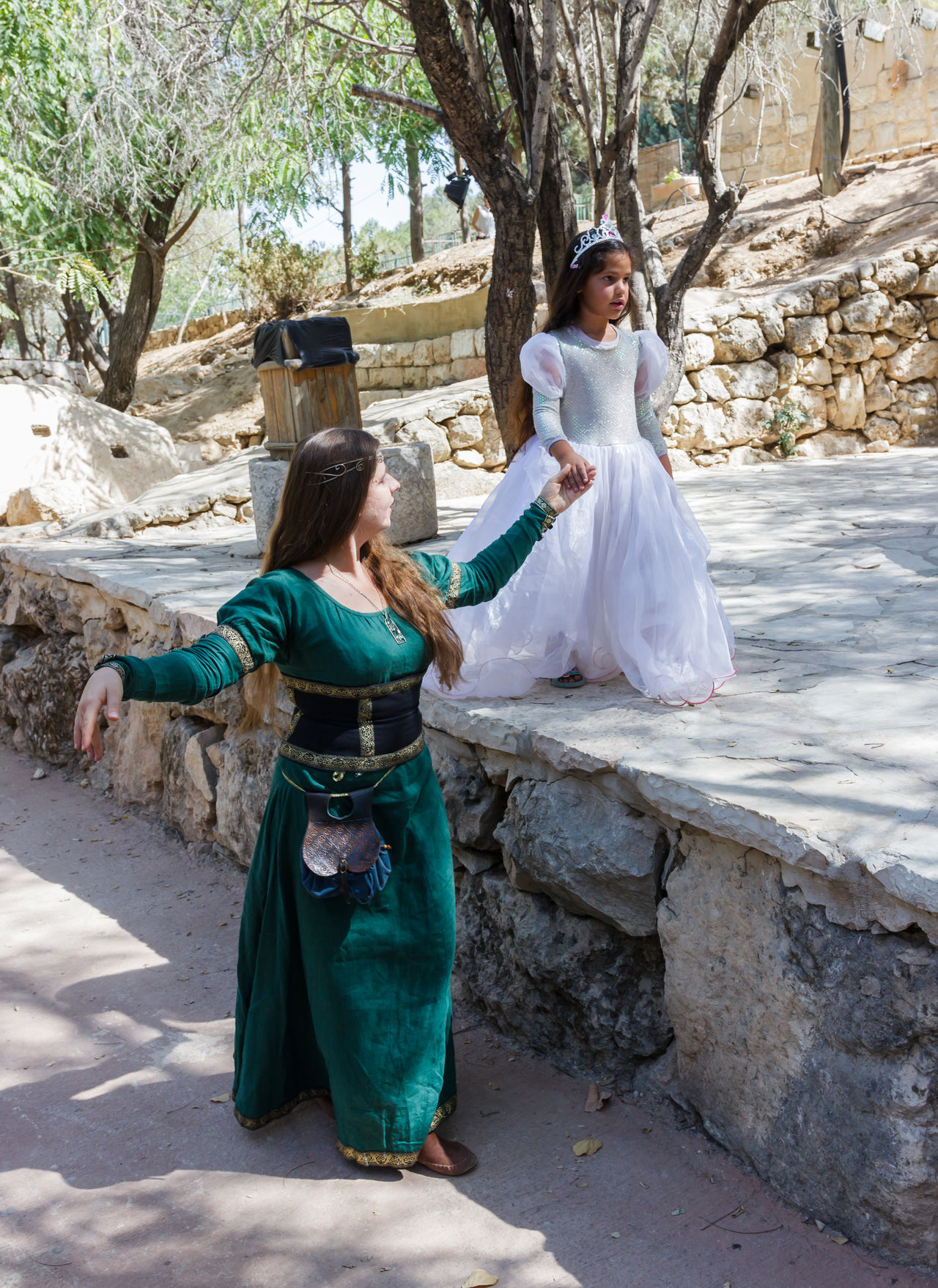 "Jerusalem, Israel, October 03, 2016: Members of the annual festival of ""Knights of Jerusalem"" dressed as a citizen and princess pose for photographer in Jerusalem, Israel Ancient Annual Attraction Christian Citizen Decorations Dressed Event Famous Festival History Holy Israel Jerusalem Knight  Land Medieval Member Old Performance Performs Photographer Pose Sword Tradition"