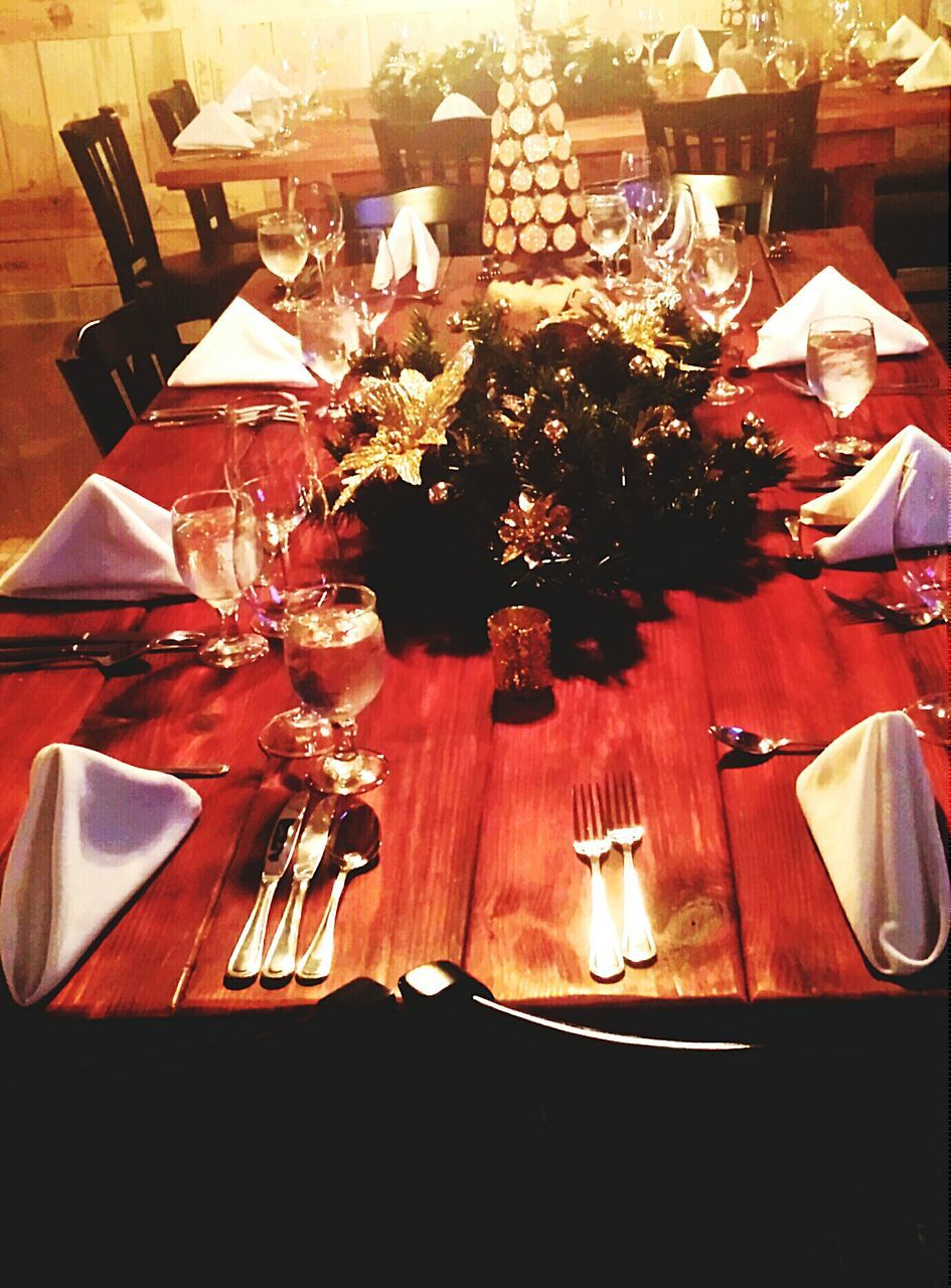 table, place setting, indoors, plate, night, dining table, food and drink, no people, celebration, fork, food, illuminated, close-up, wineglass, freshness