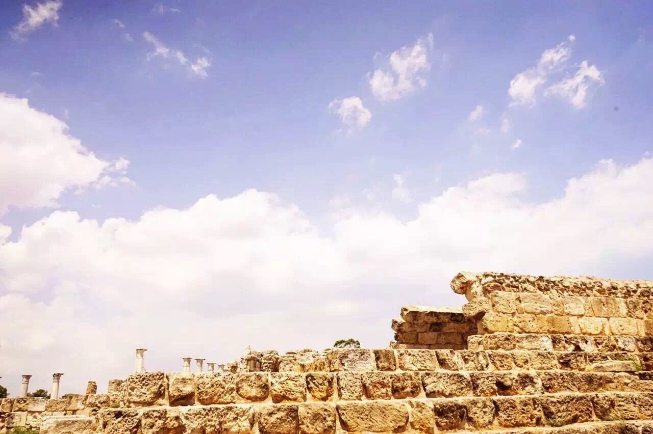 history, old ruin, cloud - sky, architecture, ancient, archaeology, built structure, ancient civilization, sky, travel destinations, stone material, tourism, day, outdoors, rock - object, building exterior, low angle view, no people, pyramid, nature