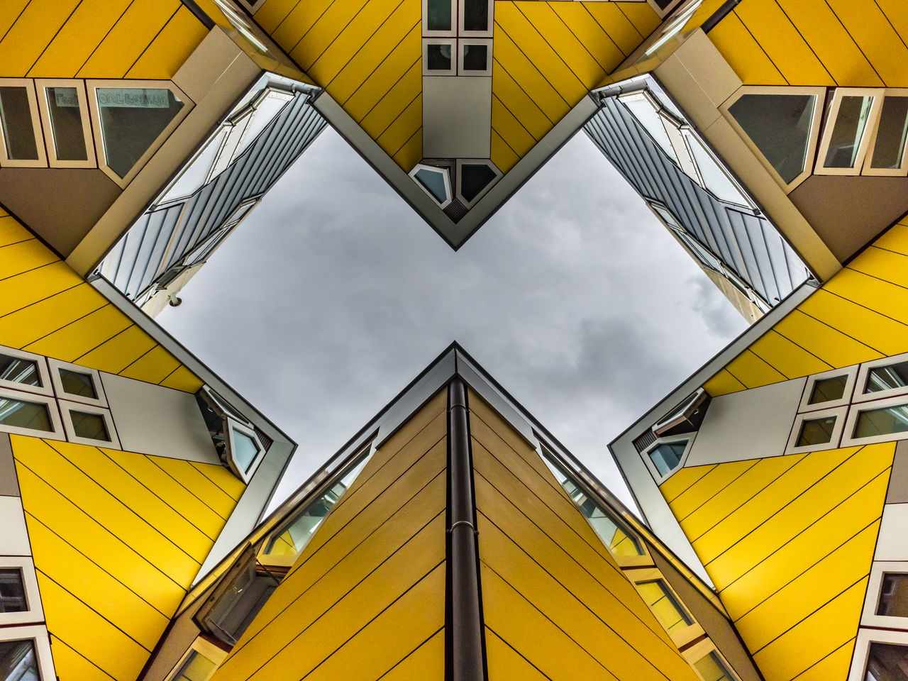 Another angle of Rotterdam's famous Cube houses, designed by Piet Blom in 1978. Architecture Blaak Blaakse Bos Building Exterior Built Structure Cube Cube Houses Day Famous Place Holland Houses Living Low Angle View Mathematics No People Outdoors Piet Blom Rotterdam Sky The Architect - 2017 EyeEm Awards The Netherlands Yellow