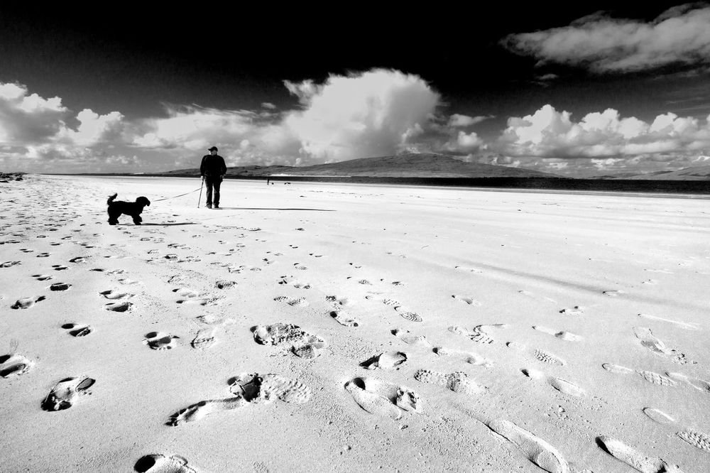 Seeking, which way now ? Animal Themes Beach Beach Photography Beauty In Nature Black And White Photography Cloud - Sky Dog EyeEmNewHere Footsteps In The Sand Footsteps On The Beac Isle Of Harris Scenes Luskentyre Beach Nature One Person Outdoors Pets Real People Remote Location Sand Scenics Sea Sea, Sky And Sand Sky Walking Wide Angle View Live For The Story