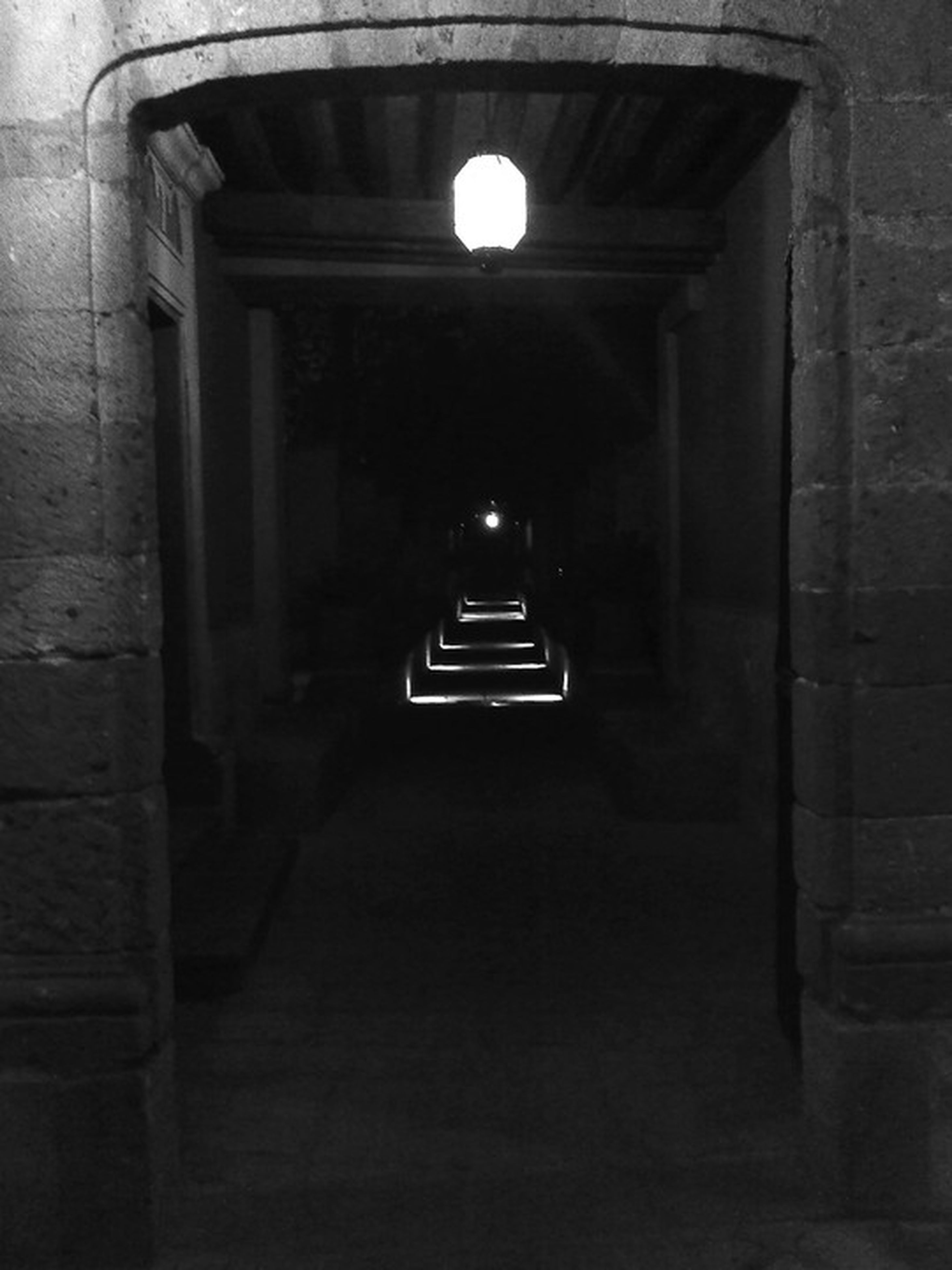 architecture, built structure, illuminated, the way forward, lighting equipment, transportation, building exterior, arch, indoors, diminishing perspective, night, street light, building, empty, vanishing point, street, corridor, tunnel, no people, absence