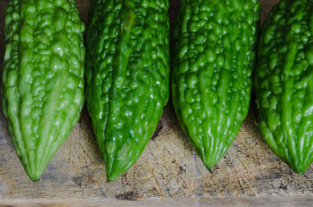 green bitter groud on wood cutting board Backgrounds Bitter Groud Bitter Melon Close-up Food Freshness Green Green Color Indoors  Vegetable Water