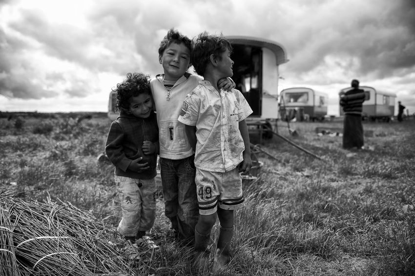 The Photojournalist - 2017 EyeEm Awards La Pièta Des Roms Childhood Boys Togetherness Grass Field Family Father Real People Casual Clothing Son Sky Girls Lifestyles Outdoors Elementary Age Child Leisure Activity Day Full Length Love Nikon D4S