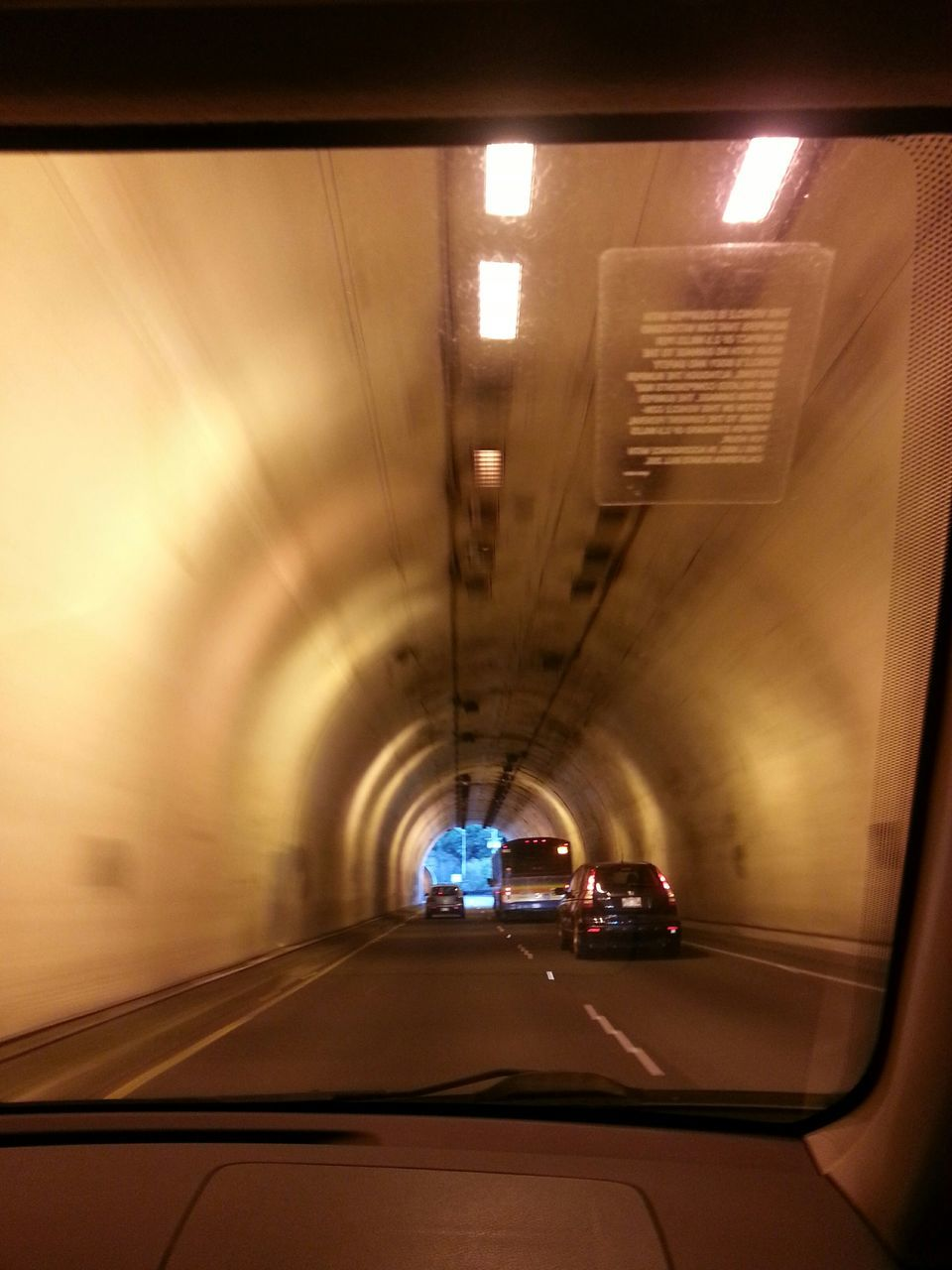 illuminated, car, transportation, the way forward, lighting equipment, land vehicle, windshield, tunnel, indoors, mode of transport, windscreen, car point of view, road, no people, built structure, night, architecture