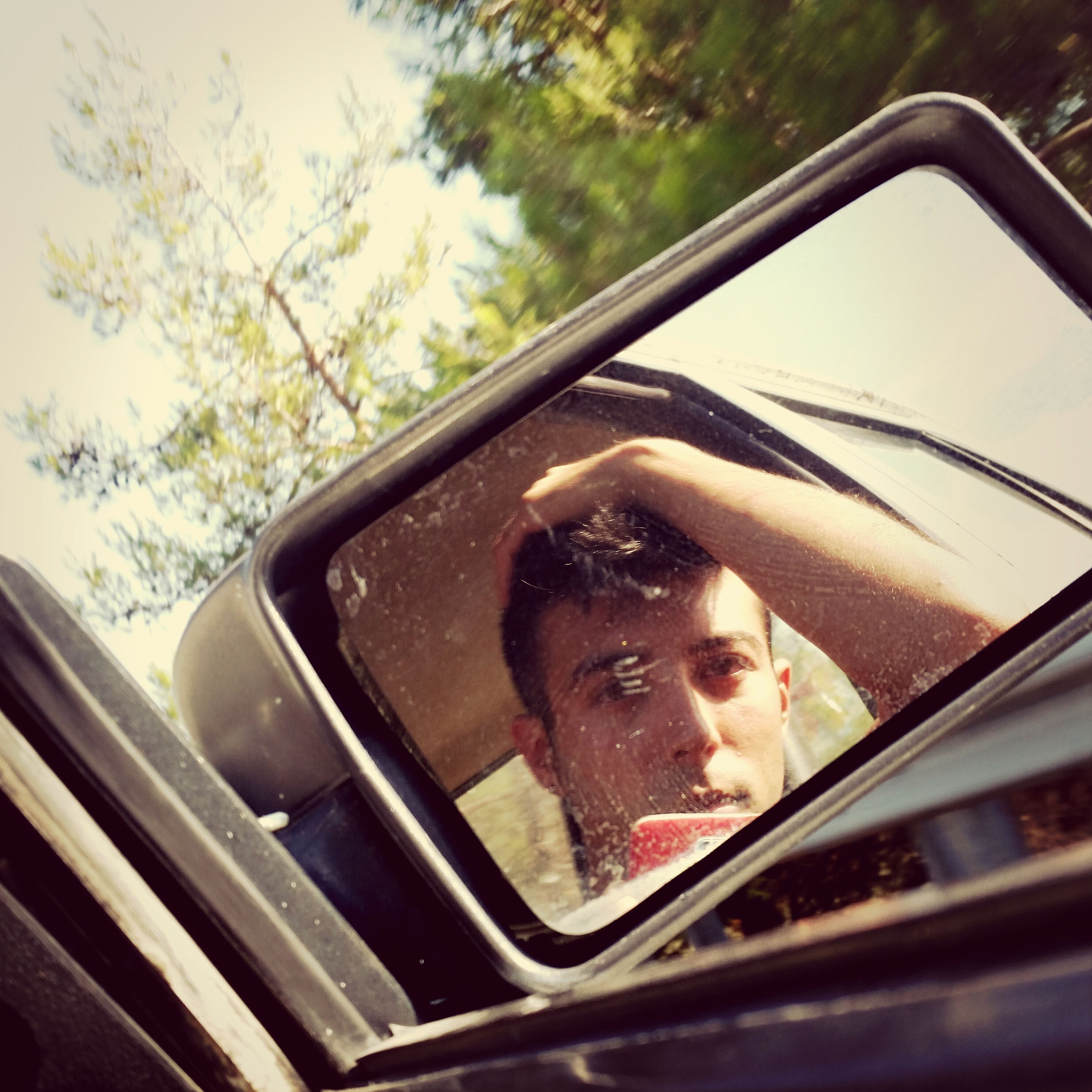 transportation, car, mode of transport, land vehicle, vehicle interior, car interior, window, young adult, looking at camera, person, travel, portrait, sunglasses, front view, headshot, close-up, glass - material, reflection