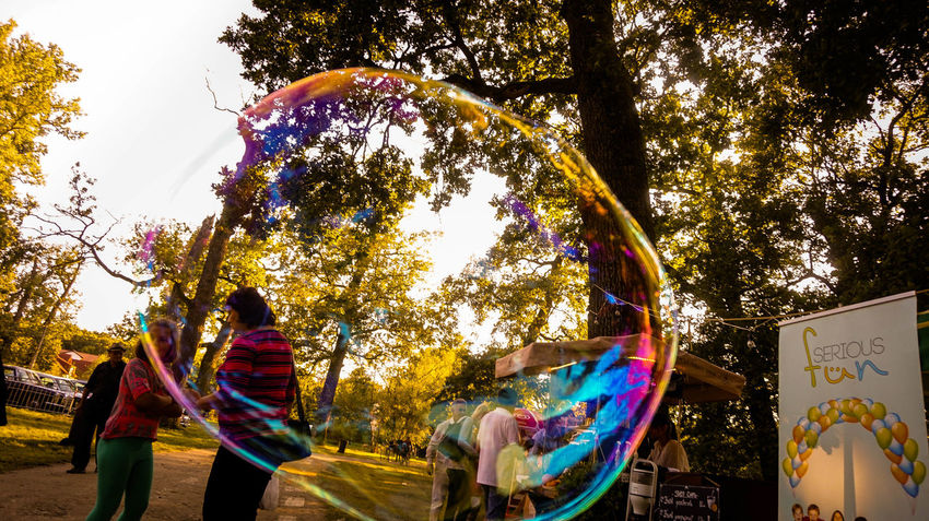 Adult Adults Only Day Leisure Activity Lifestyles Men Multi Colored Nature Outdoors People Real People Sky Soap Bubbles Togetherness Tree Two People Women