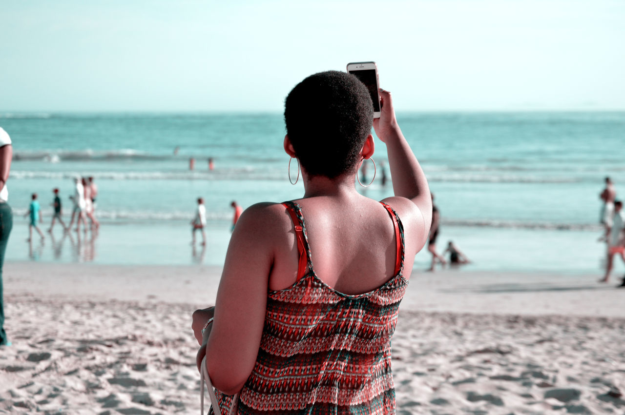 Beautiful stock photos of candid,  Beach,  Candid,  Cellphone,  Clear Sky
