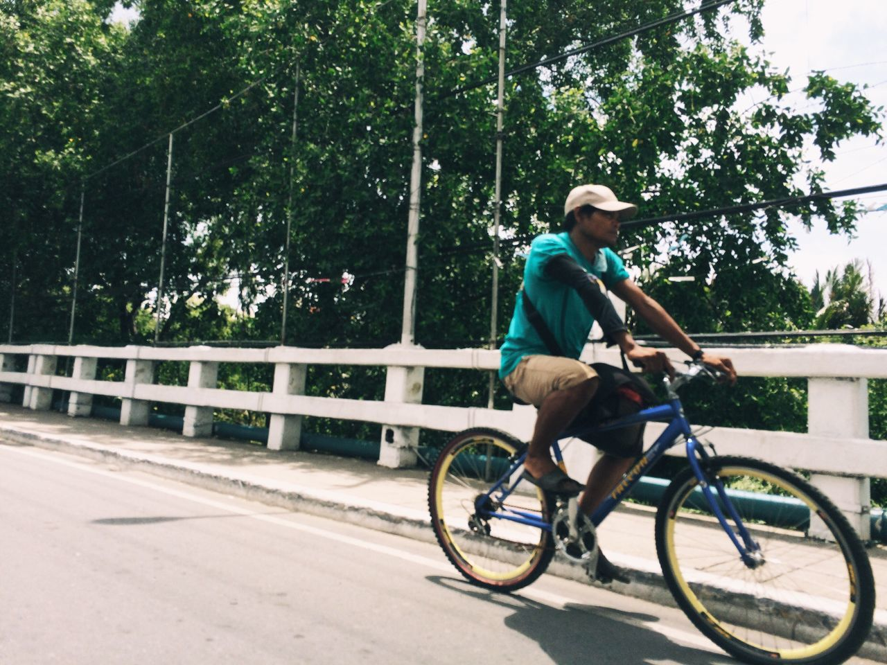 bicycle, full length, cycling, tree, one person, transportation, riding, day, young adult, outdoors, leisure activity, side view, motion, nature, one young man only, people, one man only, cycling helmet, adults only, adult, only men
