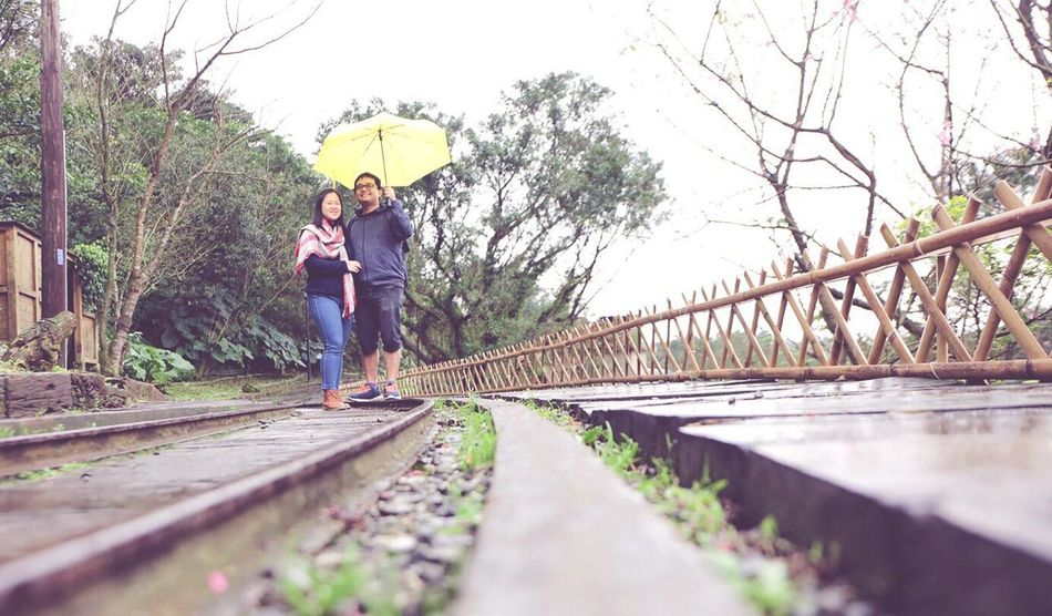 Train Train Tracks Couple Couples Shoot Landscape Unbrella Yellow Cold Temperature Raining Rail Transportation Railroad Track Day Outdoors People Travel Holiday