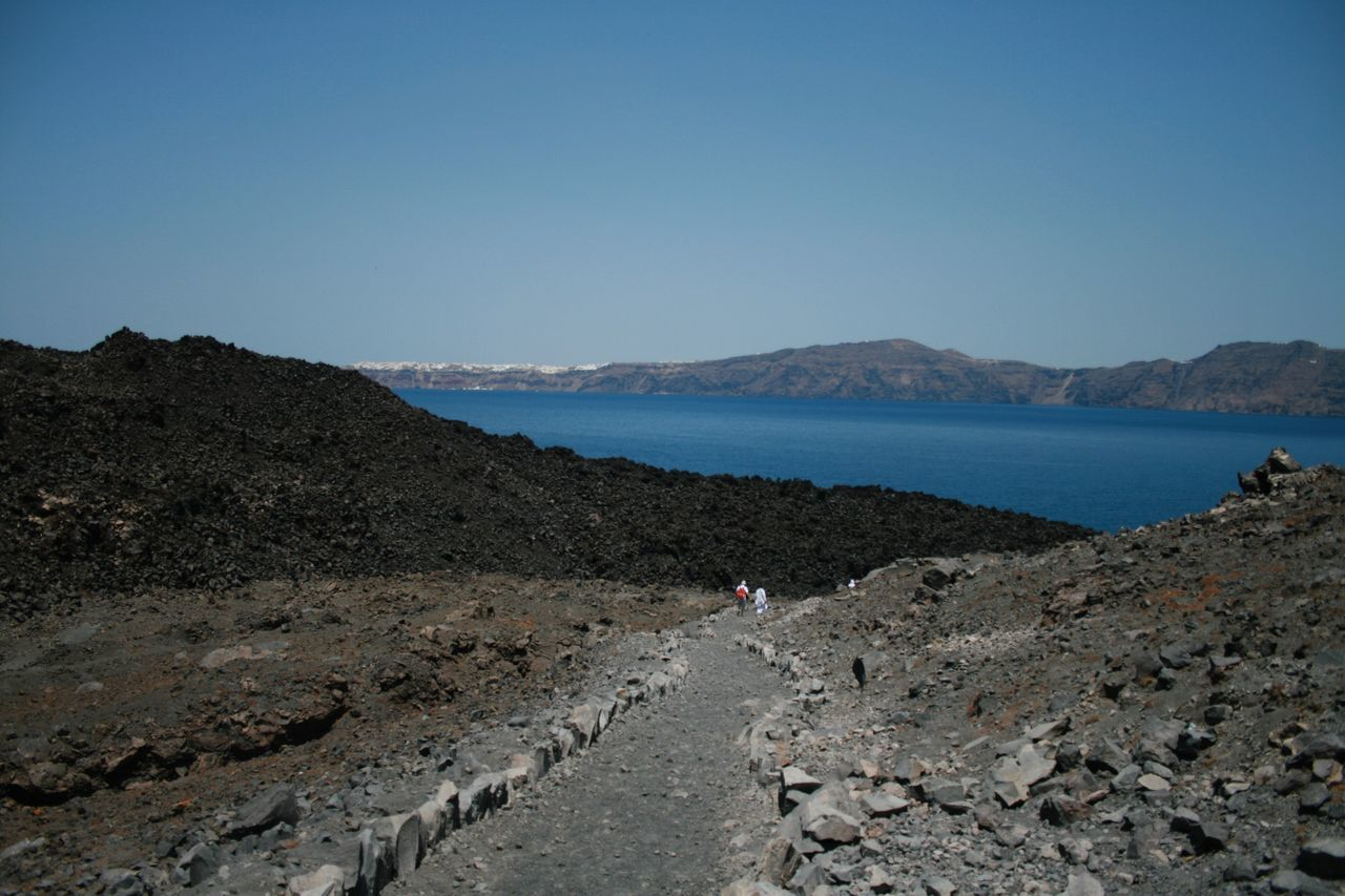 Walking on a Vulcan, Santorini Clear Sky Sea Beach Tranquil Scene Tranquility Nature Scenics Blue Beauty In Nature Outdoors Water Sand Horizon Over Water Day Mountain Sky Rock Formation Travel Destinations Santorini, Greece Canonphotography Vacations Canon400d Vulcano Landscape